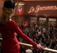 Kill all Nazis: Melanie Laurent faces the troops in 'Inglourious Basterds.' Right: Brad Pitt wields a blade in director Quentin Tarantino's latest film. | © 2009 UNIVERSAL STUDIOS. ALL RIGHTS RESERVED.