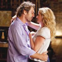 Lust in translation: Spaniard Felipe (Javier Bardem) gets up close and personal with American traveler Liz (Julia Roberts) in 'Eat Pray Love.'