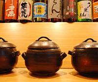 Eight different kinds of freshly harvested rice are offered at Kokoromai in Shirokane, all cooked and served in ceramic do-nabe pots. Head chef Masanori Yoshida (bottom) also produces a fine range of other Japanese specialties. | ROBBIE SWINNERTON PHOTOS