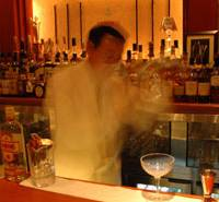 Kazuo Ueda (above) is a blur as he demonstrates his famed Hard Shake technique at Bar Tender, Ginza; at Peninsula Tokyo hotel's bar Peter, the Tokyo Joe is the signature cocktail of senior bartender Mari Kamata. | NICHOLAS COLDICOTT (ABOVE), YOSHIAKI MIURA PHOTO