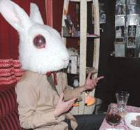 A customer at Sumire no Tenmado tries on the bar's rabbit mask.