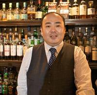 Liquor legend: Hisashi Kishi (right) is the proprietor of Ginza's Star Bar and a former International Bar Association world champion.