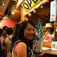 Misaki Okutsu, a regular Smile Nihonshu attendee, says, 'Sake is my favorite drink, and this event is really fun because I'm able to talk with people from lots of different groups.' | MELINDA JOE PHOTO