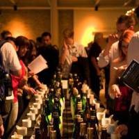 Just a taste: Visitors choose sakes to taste from a table filled with different varieties at The Joy of Sake San Francisco. To celebrate its 10th anniversary, The Joy of Sake comes to Japan on Nov. 2, and includes 329 premium brews from 166 producers across the country. | THE JOY OF SAKE