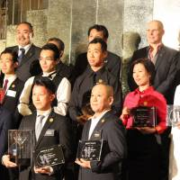 Winner of the Diageo World Class Japan Final Tsuyoshi Miyazaki stands front, center, surrounded by other prize winners at the national cocktail competition. | DRINK PLANET