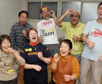 Participants in a recent Laughter Yoga class held at the Kichijoji Laughter Club in western Tokyo display with delight the joyful, infectious levels of levity the practice has helped them to share. | YOSHIAKI MIURA PHOTO
