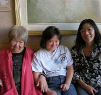 A flyer for screenings of the film 'Fudeko Sono Ai — Tenshi no Piano' (top); and (above) the film's director, Hisako Yamada (left) with Hiromi Ashmore and her daughter Elena (center) in Los Angeles in November 2007. | PHOTOS © GENDAI PRODUCTION; COURTESY OF HIROMI ASHMORE
