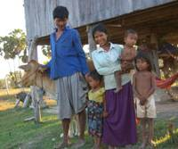 A family which benefitted from microcredit in the form of cows