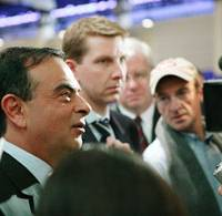 Diversity embodied: Corporate Vice President for Global Communications Simon Sproule (center) shadows his boss, Nissan CEO Carlos Ghosn (left)