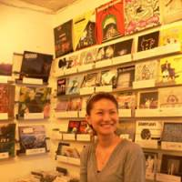 Spin doctor: Escalator Records' Haruka Naka in the indie-specialist company's Harajuku, Tokyo, shop with some of its new 45s in racks on the wall behind | DAVID HICKEY PHOTOS