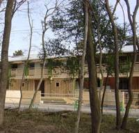 he newly completed school building stands amid the trees in a wooded area. The school is accepting up to 80 students for elementary education, or 16 each for grades one through five, in the new school year starting in September. | COURTESY OF MASAYASU KANO