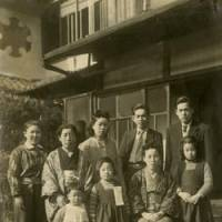 Home sweet home: Miyazaki (front row, left) with his mother (front row, seated), two elder sisters (front row), servants and others on the family's Kyoto estate | MANABU MIYAZAKI