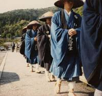 Ever so humble: Sokun Tsushimoto (second from right) when he was around 30, wanders the street with a group of fellow trainee monks from Tenryuji Temple in Kyoto as they ask for alms in the city's Arashiyama district. He later became superintendent priest of a temple in the countryside, where he says that 'even within that small organization there were factions and there was political infighting.' | SOKUN TSUSHIMOTO