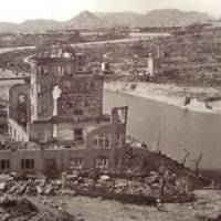 Ground zero: Hiroshima after the bomb, as seen in a photo displayed at the city's Peace Memorial Museum, and what is now known as the A-bomb Dome, today's iconic symbol of that event on Aug. 6, 1945. | JEFF KINGSTON PHOTOS