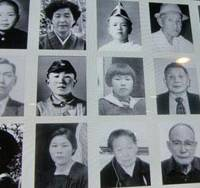 Lives extinguished: Faces of some of the hundreds of thousands of atomic-bomb victims mutely gaze out at visitors to the Hiroshima National Peace Memorial Hall.