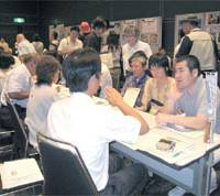 Let's sea: Fishermen and fishery officials meet with some of the 250 visitors to the fishery jobs recruitment fair held in Tokyo's Yurakucho district on July 25. | ERIKO ARITA