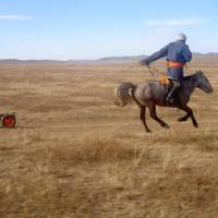 Horsepower: A Mongolian charges a discarded battery the Fujimura way (above). | YASUYUKI FUJIMURA PHOTO