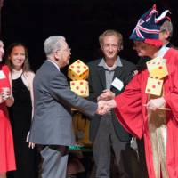 No joke: Wearing a jaunty robe and jester's hat, English Nobel laureate Sir Richard Roberts shakes hands with Fumiaki Taguchi and presents him with his Ig Nobel award. | FUMIAKI TAGUCHI