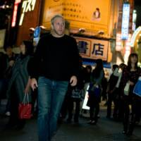 Night owl: Matt Naiman at a crossing in Tokyo's Shibuya, where he has run several bars and restaurants. (Below) Naiman gets hands-on at his Ruby Room bar. | TADAMASA IGUCHI PHOTOS