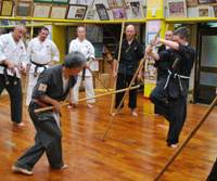 Karate master: Tetsuhiro Hokama teaches visiting practitioners from Canada and France the art of fighting with sticks.