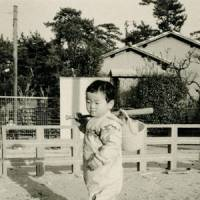 Starting out: Even as a toddler, Kuwata was passionate about baseball, and is seen here carrying a bat and a bucket containing a glove and ball. | COURTESY OF MASUMI KUWATA
