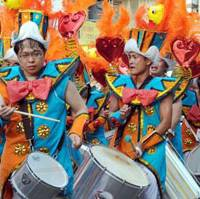 Rhythm sticks: G.R.E.S. Liberdade team's drummers pound out the low, powerful beat that's at the heart of Brazilian samba music.