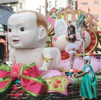 Winning smile: The huge baby doll that adorned the Saude team's float on the theme of 'Amor' ('Love') surely played a part in its triumph.
