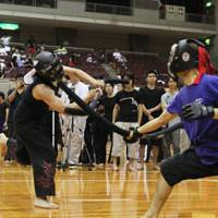 Battle ready: Two children compete in datotsu kyogi (hitting games). Below: Practitioners fight during a game. | JAPAN SPORTS CHANBARA ASSOCIATION