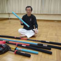 Tetsundo Tanabe, sport chanbara's creator, displays the weapons players can use during competition. | TOMOKO OTAKE PHOTO