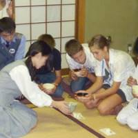 Hands-on: Foreign students learning Japanese take part in a tea ceremony lesson at Toko Gakuen in Kawasaki on Sept. 15, while students from Sri Lanka and Hungary (above) are given lessons in Japanese archery at the school, both as part of a nine-day exchange visit in Japan.   MAMI MARUKO PHOTO