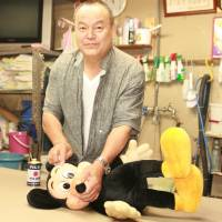 Mice work: Sadaharu Yoshinaga restores Disney's famed rodent to sparkling life in his Miyazaki City workshop. | EDAN CORKILL PHOTO