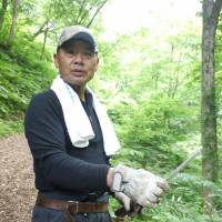 Point man: Bear-hunter Takashi Yoshikawa leads the way on our trek in the mountains. | TOMOKO OTAKE PHOTO