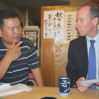 Shared loss: Sung-won Kang and Charles Lacey  meet in a Tokyo restaurant in 2011 to discuss their concerns over the police investigations into the deaths of their loved ones. | SIMON SCOTT