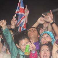 Aural action: Music lovers lap it up in a moshpit at Fuji Rock Festival. This year saw a lot of rain on Friday, which was compensated for by some sublime performances from the likes of Lily Allen, Patti Smith and Oasis, while on Saturday and Sunday the sun did shine. | ROB SCHWARTZ