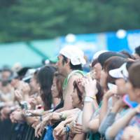 Sing when you're winning: Music fans endured the rain all weekend to catch their favorite acts. With the headliners failing to impress on the whole, there was hope from a batch of relative newcomers that future Fuji Rock Festivals won't be all wet. | ALEXIS WUILLAUME