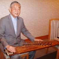 Instrumental: Hwang Byung Ki poses with a kayagum, a traditional Korean 12-string zither. | ERIKO ARITA PHOTO