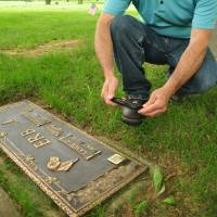 High-tech tombstones let loved ones live on, virtually