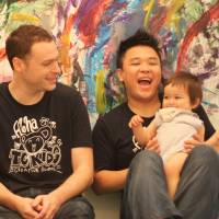 Three men and a baby (L-R): Tokyo Creators' teachers Skip, Isaac and Masa use music, painting and laughter to help their young students get creative. | DANIELLE DEMETRIOU