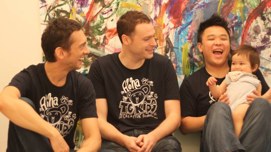 Three men and a baby (L-R): Tokyo Creators' teachers Skip, Isaac and Masa use music, painting and laughter to help their young students get creative.