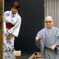 Traditions combined: Sakata Tojuro helps Akie Amou prepare for her performance as Kaede in 'Shuzenji Monogatari.' | YOSHIAKI MIURA PHOTO