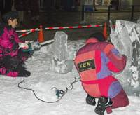 Sculptors at work at Susukino Ice Festival