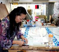 Luce's Mieko Shibata prepares a stained-glass work