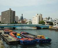 Water ways: The Kizu River (above) is a colorful bustle of activity, while Dotonbori Canal runs through the 'fun' Minami zone (below). | CHRIS PAGE PHOTOS