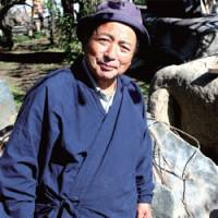 Bamboozling beauty: Garden wizard Sadao Yasumoro, and a fence design that was recently created by his young apprentice at Yushima Tenjin shrine.