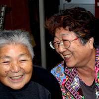 Livewires: Kazuko Okubo (left) and Ayako Kikukawa share lots of laughs together over coffee — and lifetime histories living in Yushima, where they appear to know every detail of the district's many fascinating features.
