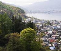 Lake frontage: Shimosuwa seen nestled between wooded hills and Lake Suwa.