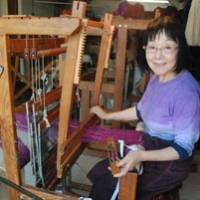 Happy work: Weaver Kazuko Teraoka sits at the hand loom in her atelier/shop, Kazu.