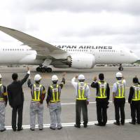 Off for Finland: Japan Airlines employees see off JAL's first Boeing 787 flight to Helsinki at Narita airport in Chiba Prefecture on Monday. | KYODO