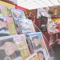 Special offer: DVDs of girl idol group AKB48 are on sale Monday at the Tower Records store in Tokyo. | BLOOMBERG