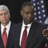 Rust belt: Detroit Emergency Manager Kevyn Orr (front) and Gov. Rick Snyder discuss the city's bankruptcy filing at a news conference Friday in the Motor City. | BLOOMBERG